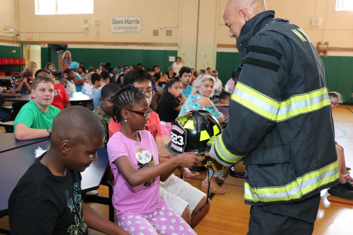 Students learn about fire prevention and fire gear.