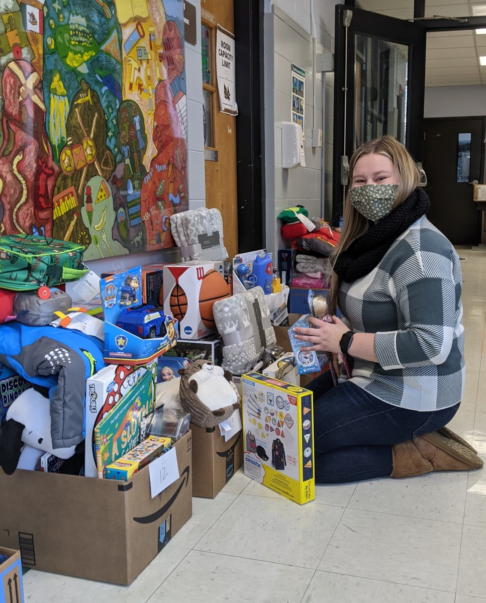 Faculty/staff member sorting donations.