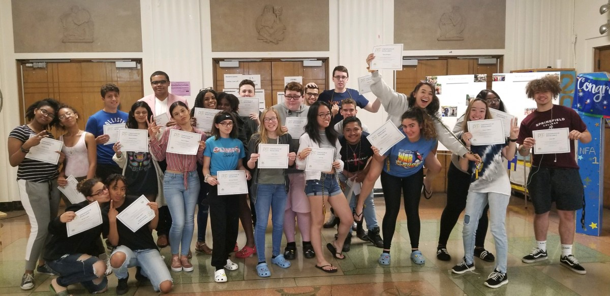 Peer group mentors stand with their certificate.