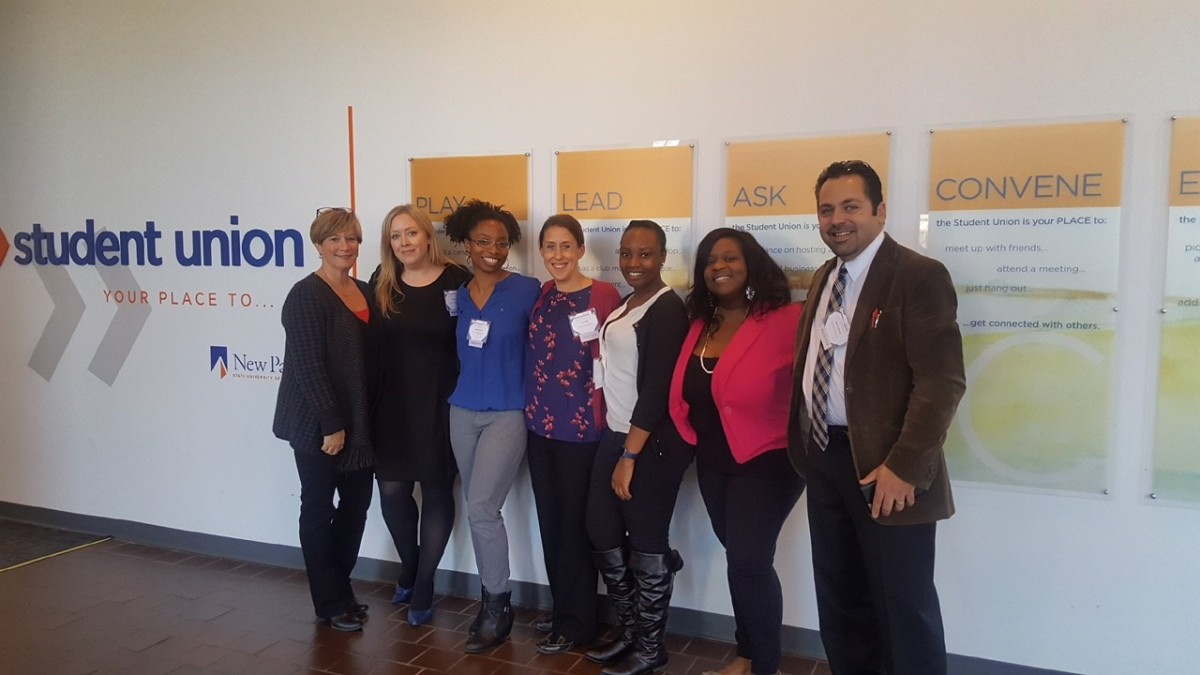 From left to right: Amy Pittari, Amy Weigel, La'Shawn Martinez, Carrie Frost, Sharol Whyte, Jessie Laguerre, Jason Michalek