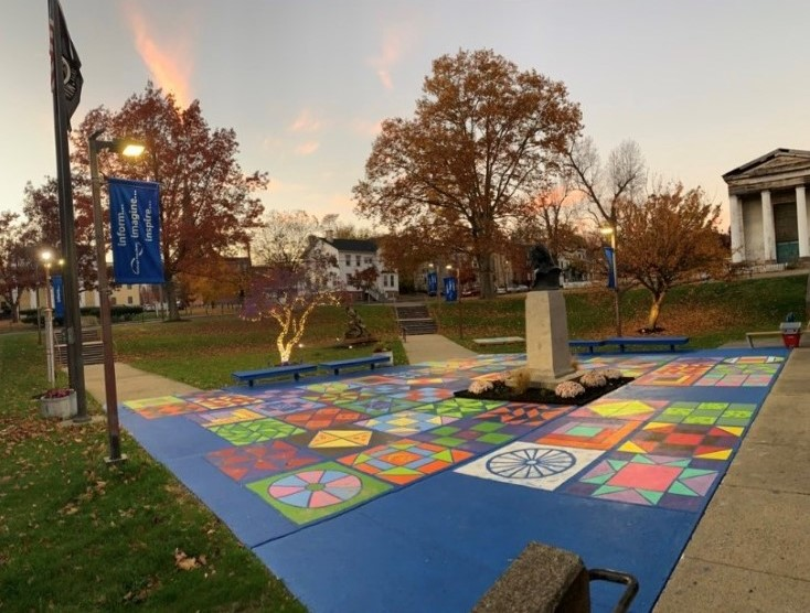 Photo of the statue with the painted Freedom Quilt in the foreground.