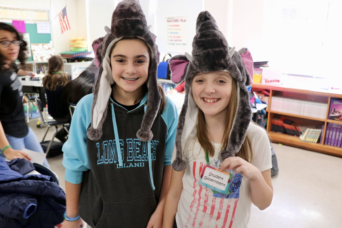 Students wearing elephant hats