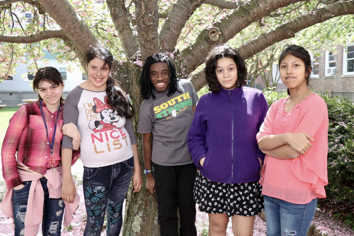 A group of students pose for the camera.