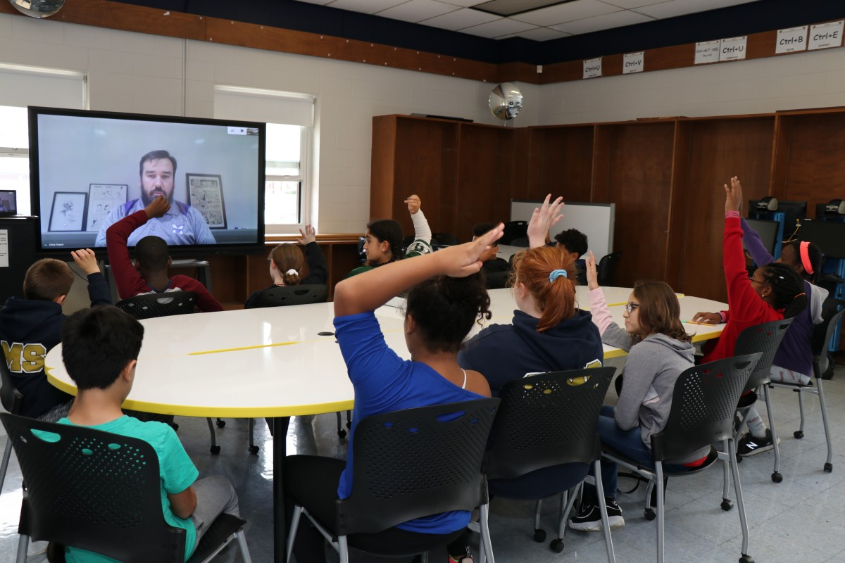 Students interact with skype presenter.