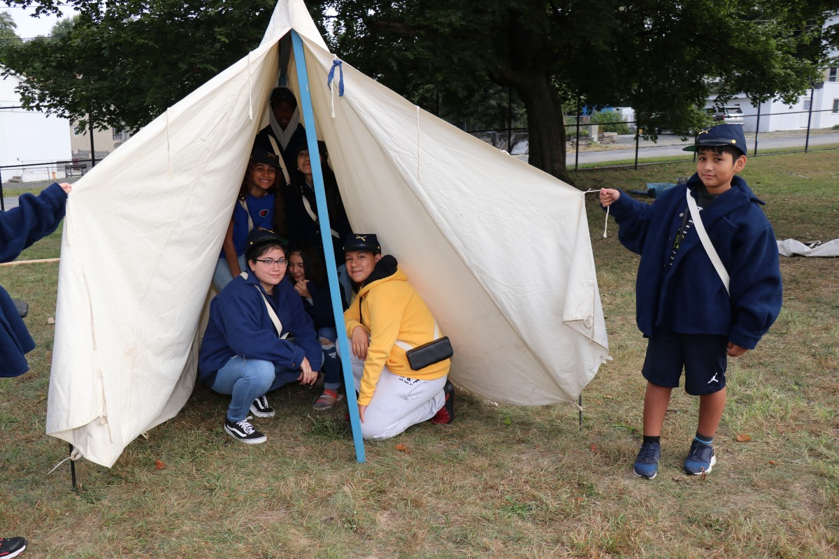 Students pose with the tent they put up.