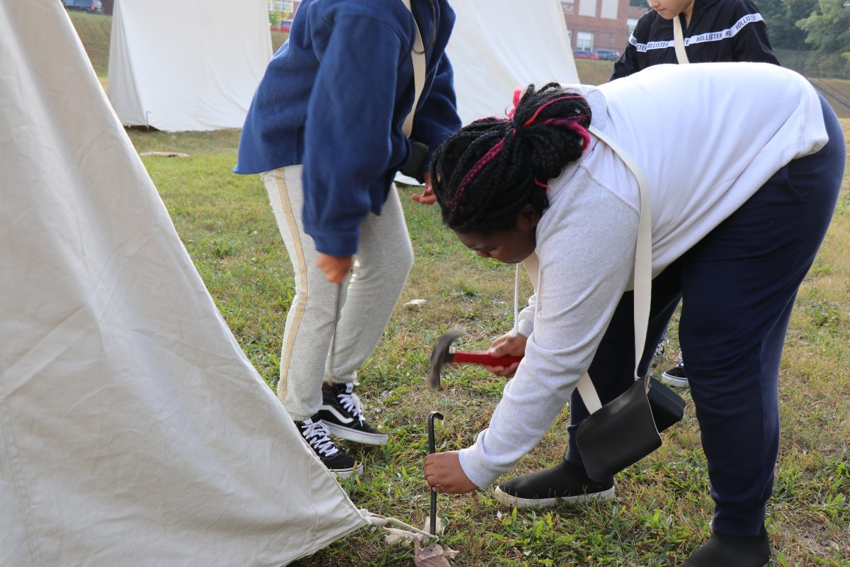 Students learn how to put up a tent.