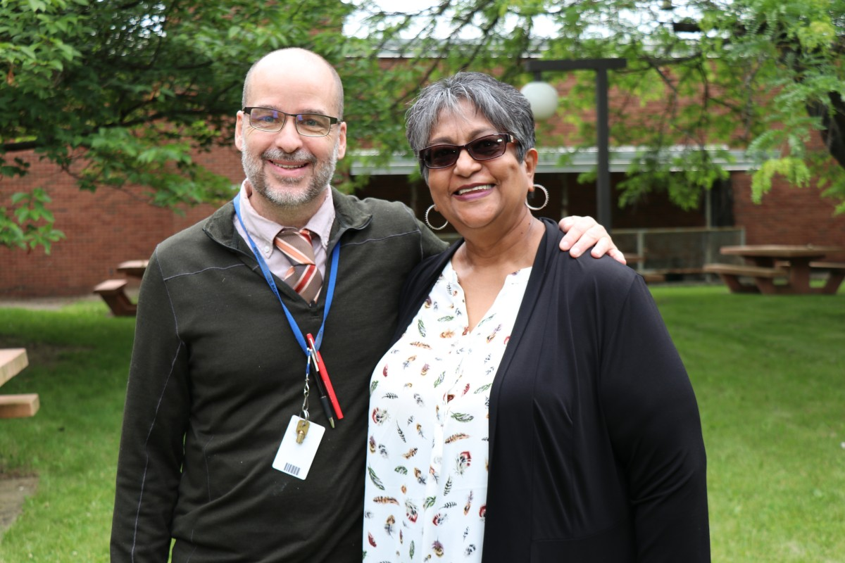 Mrs. Sukhai and Mr. Hickey pose for a photo.