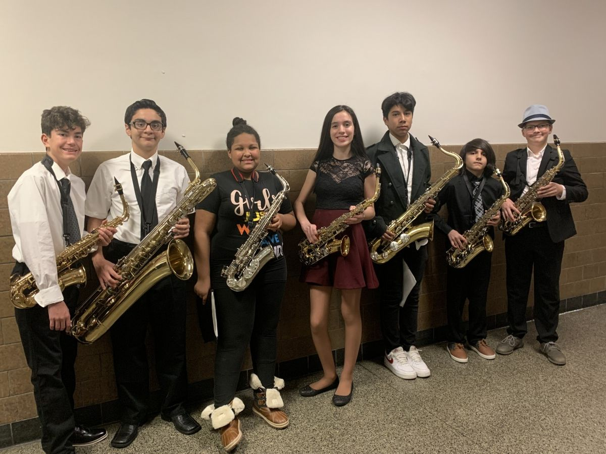 Students pose for a photo with their instruments.
