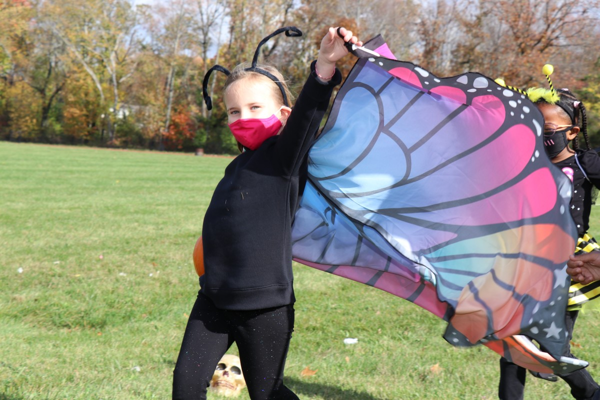 Student wears costume and marches in parade.