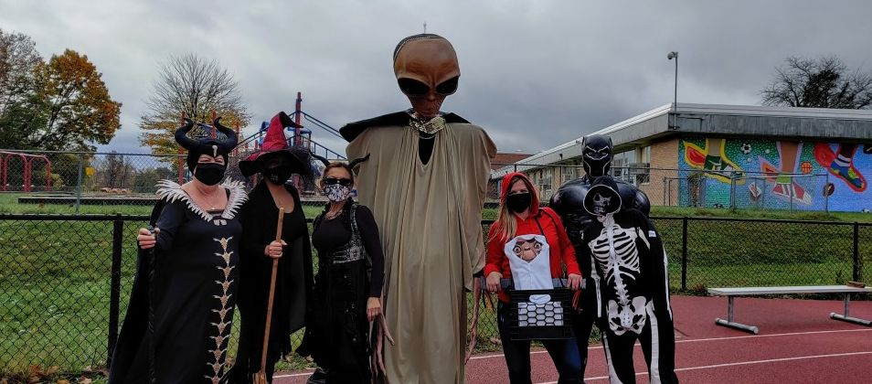 Group pose for a photo in costumes.