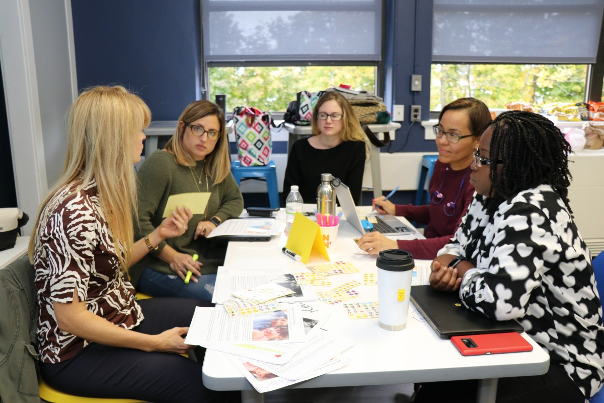 Teachers engage in professional development exercises.