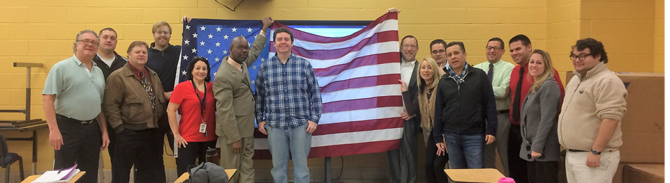 NFA History Department poses with flag