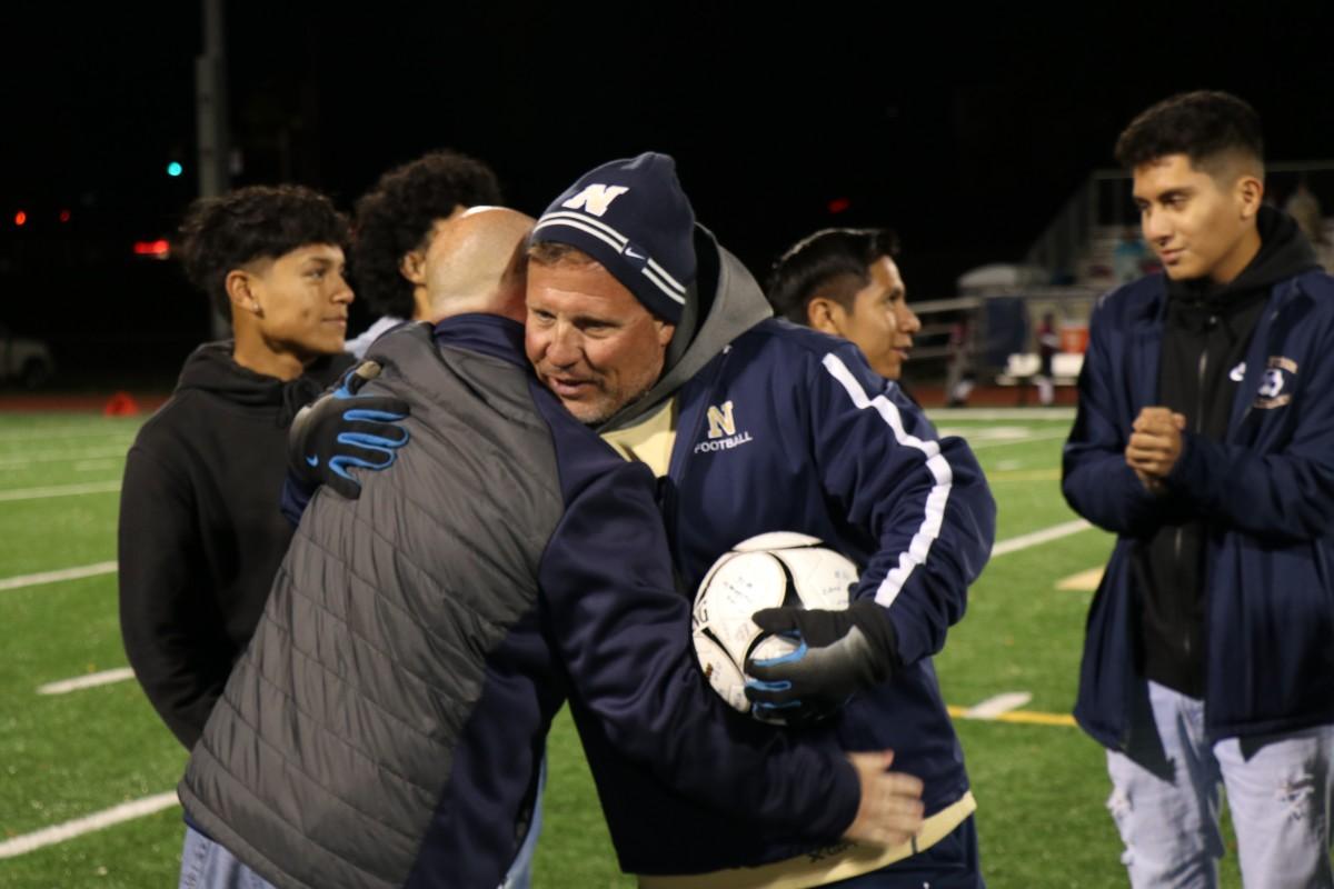 Coach Iorlano receives a congratulatory hug.