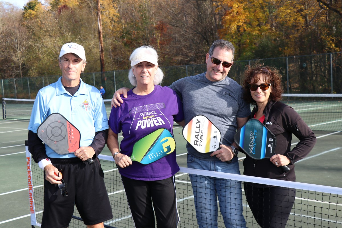 Pickleball players pose for a photo.