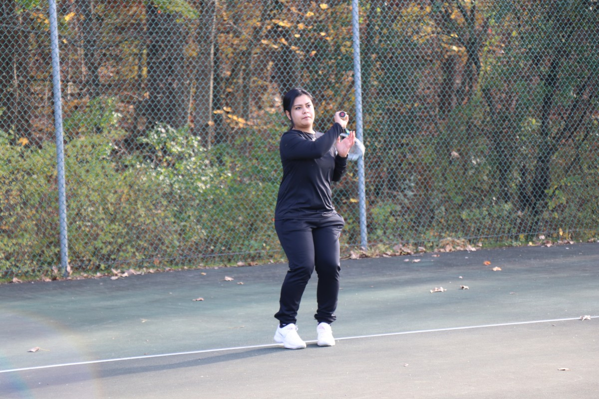 Participant playing tennis.