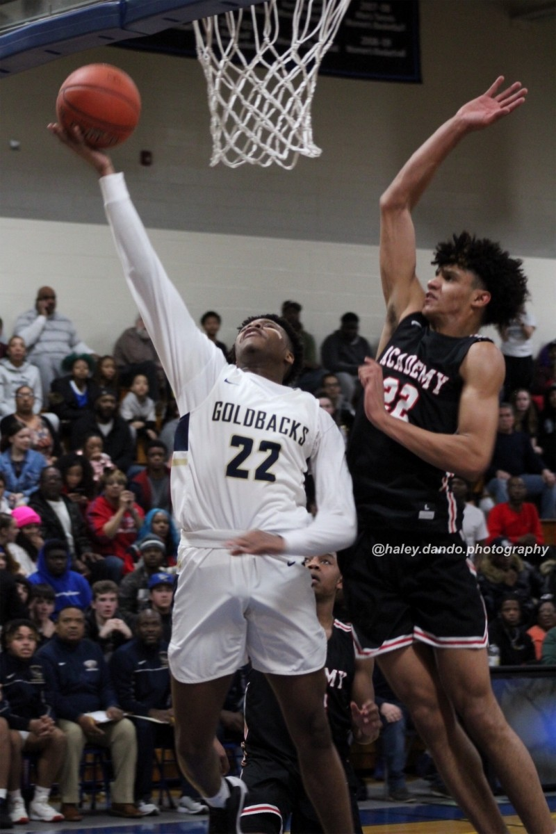 Ernest Elliot goes up for a shot against Andre Jackson from Albany Academy.