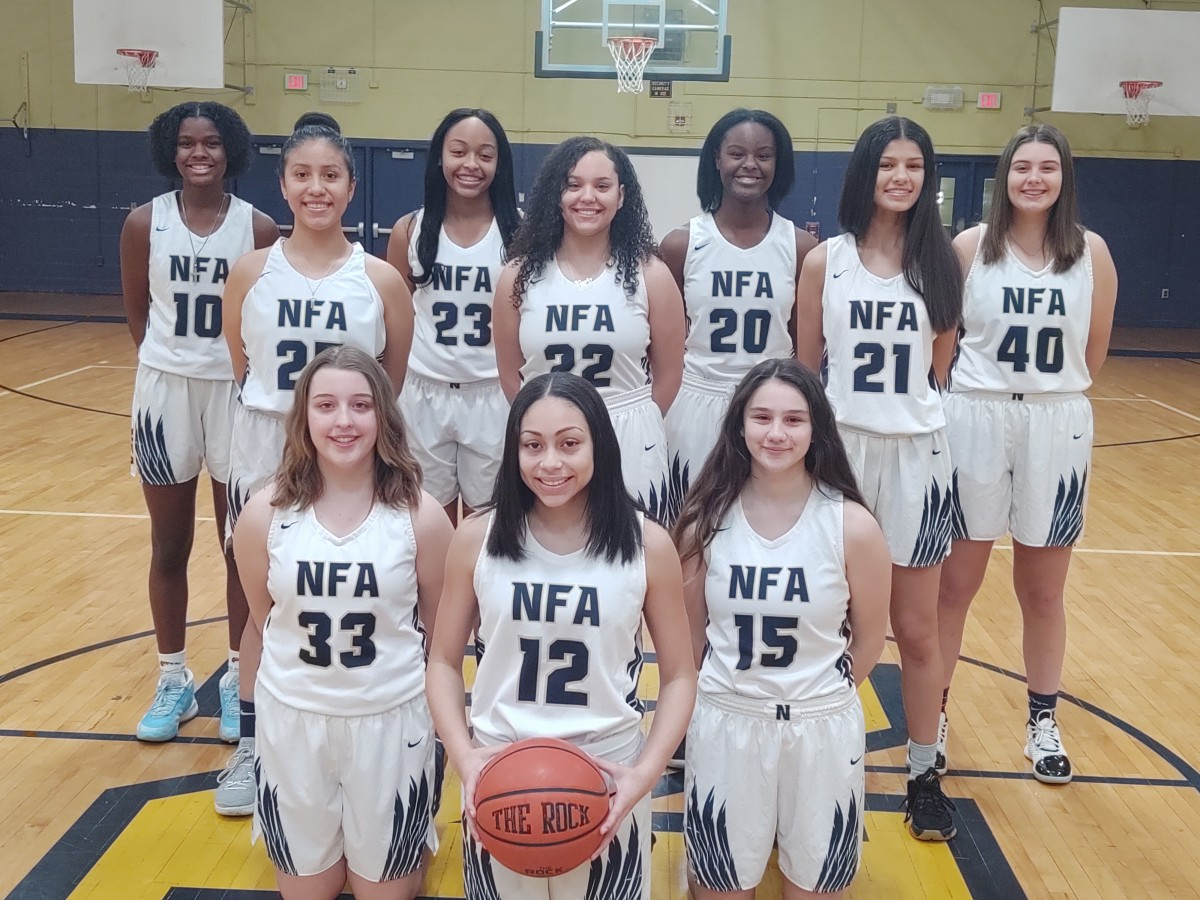 NFA Girls Basketball team poses for a photo.