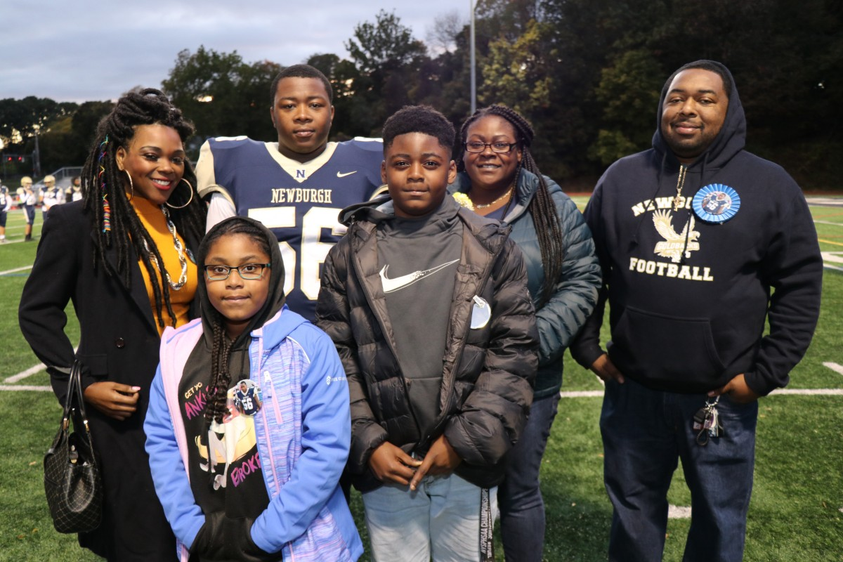 Athlete and family members pose for a photo.