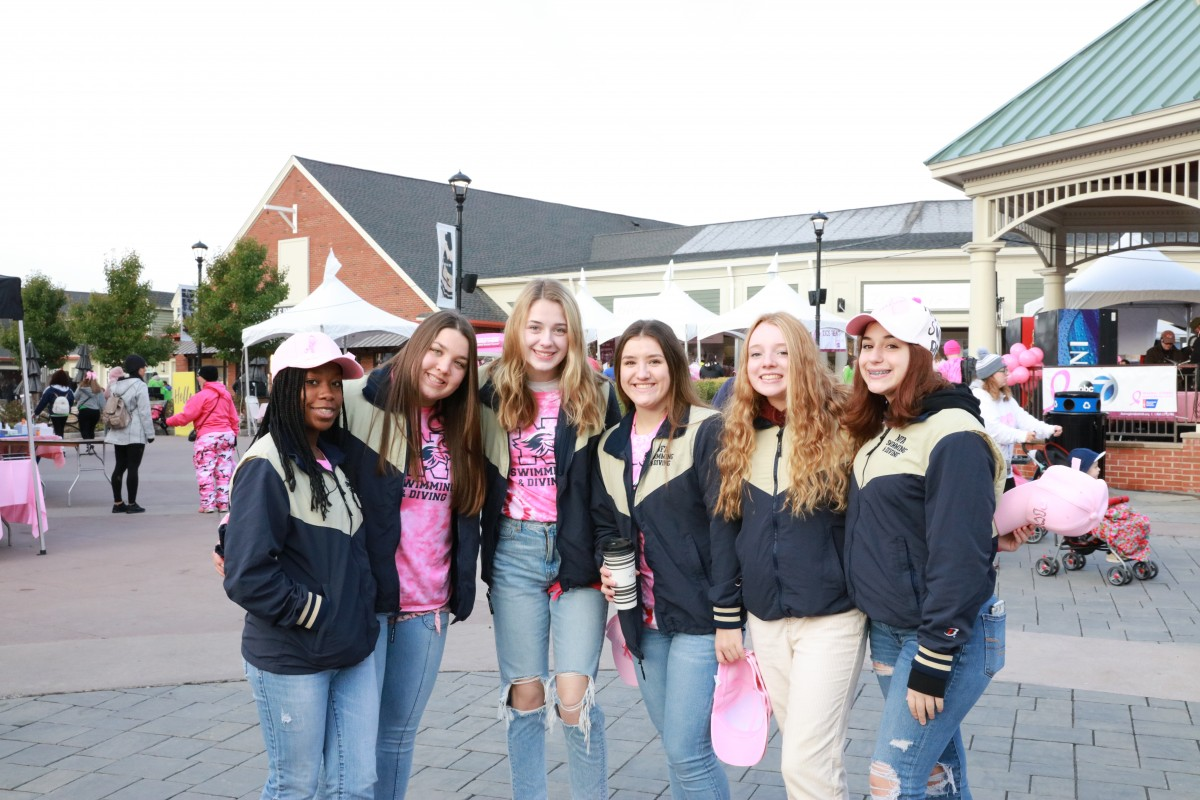 Team poses for a photo at annual Breast Cancer Walk.