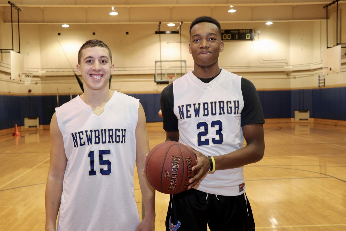 Sr. #15 Jake Cook and Jr. # 23 Caleb Simmons were recognized as individual Scholar-Athletes from Boy's Basketball