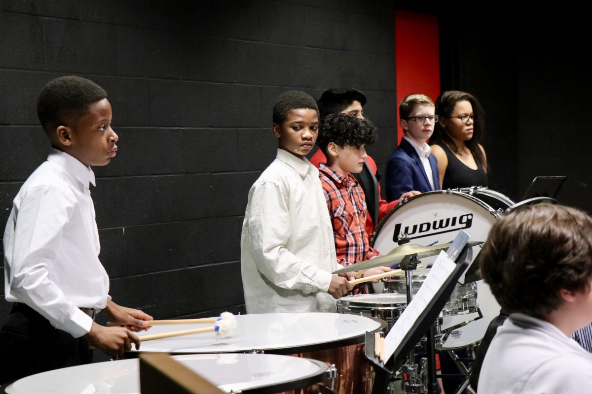 Students play percussion instruments