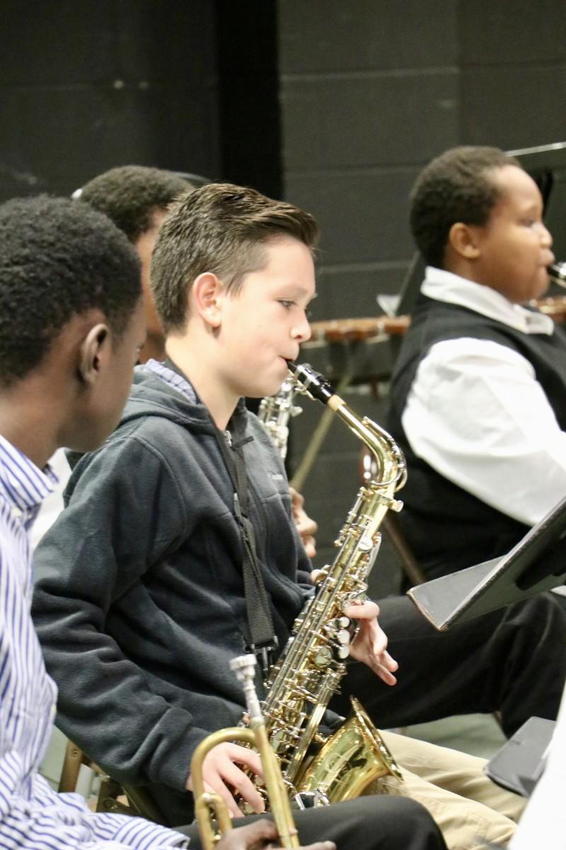 Student plays saxophone