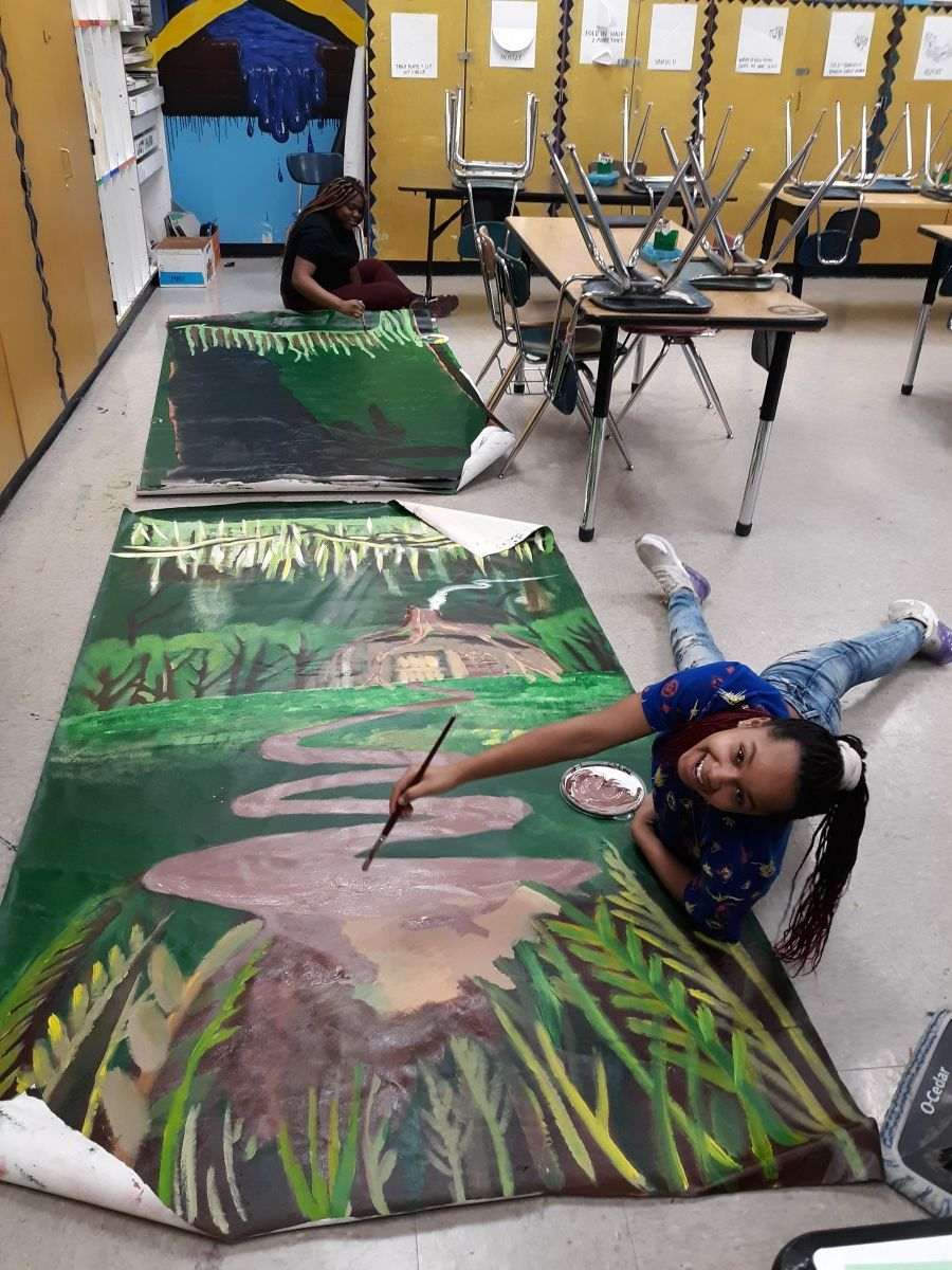 Scholars collaborate to paint sets for Shrek.
