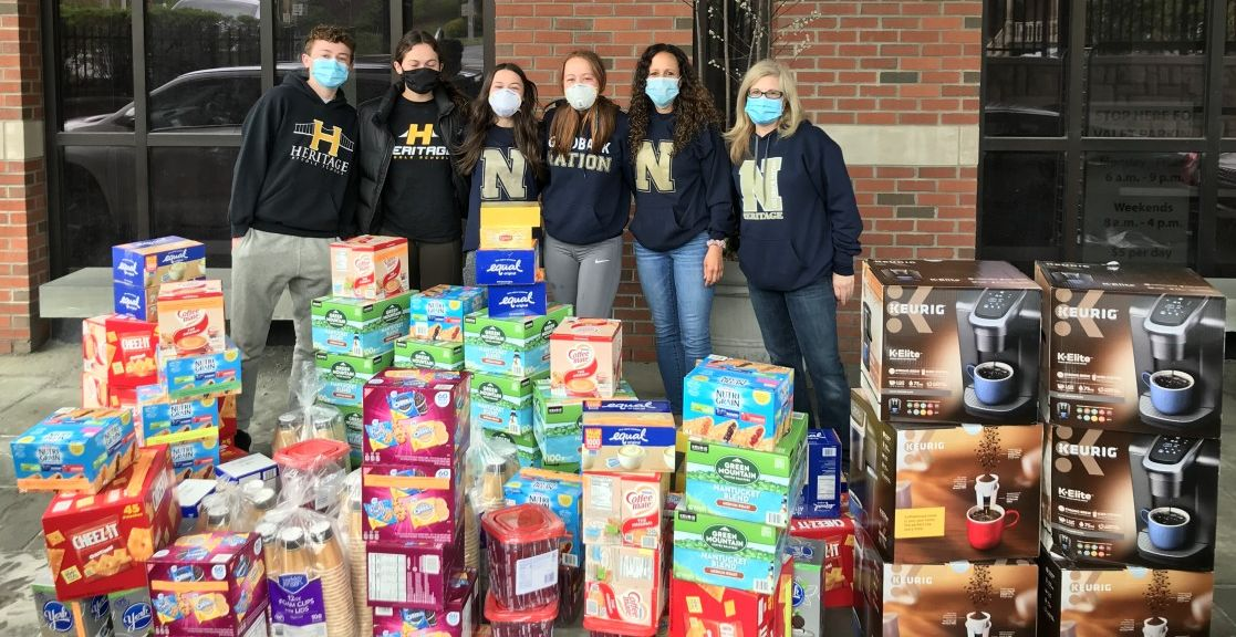 Heritage Middle School volunteers pose with donated items outside the hospital.