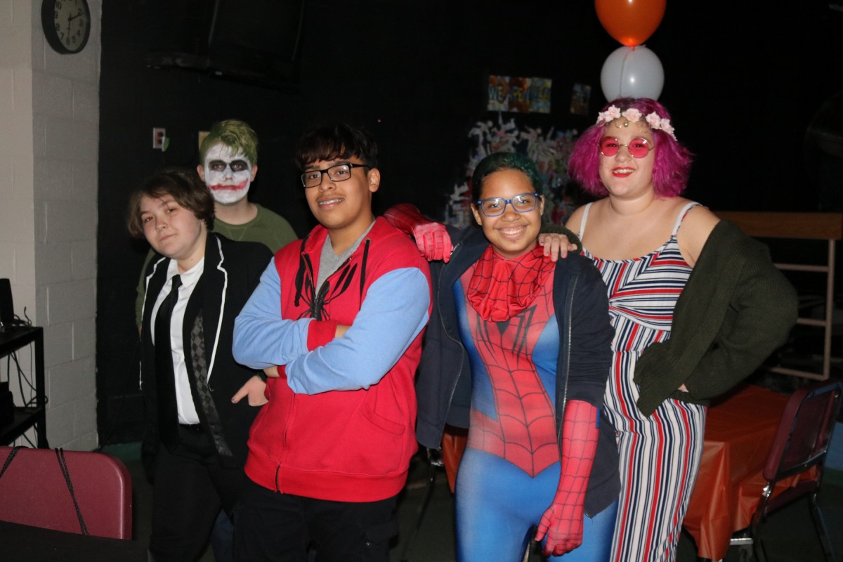 Students pose for a photo in their costume.