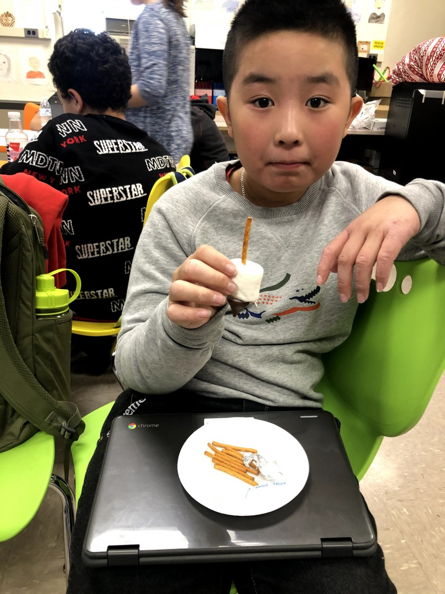 Student with plate of food.
