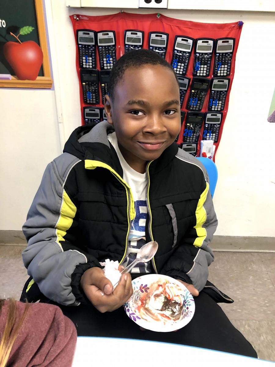 Student enjoying ice cream sundae.