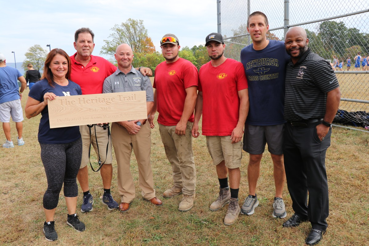 Lynn Warren stands with workers, Coaches Workman and Marino, Athletic Director Edgar Glascott and Director of Physical Education Howie Harrison.