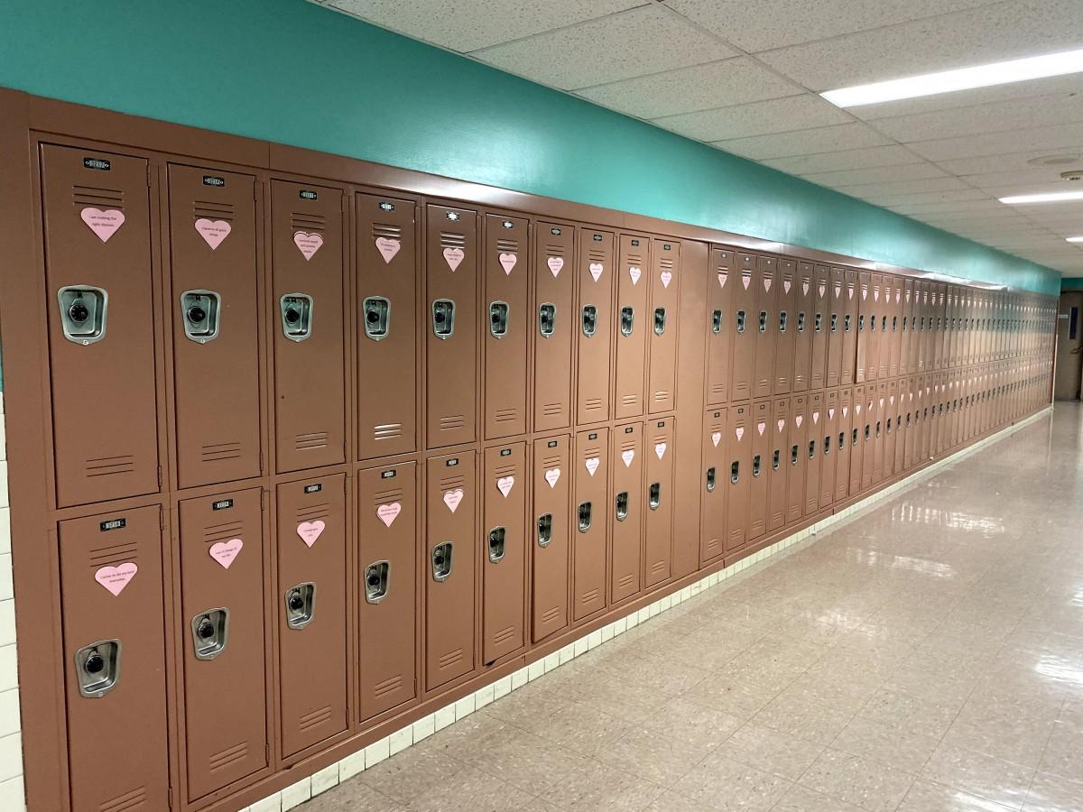 Row of lockers with affirmations on it.
