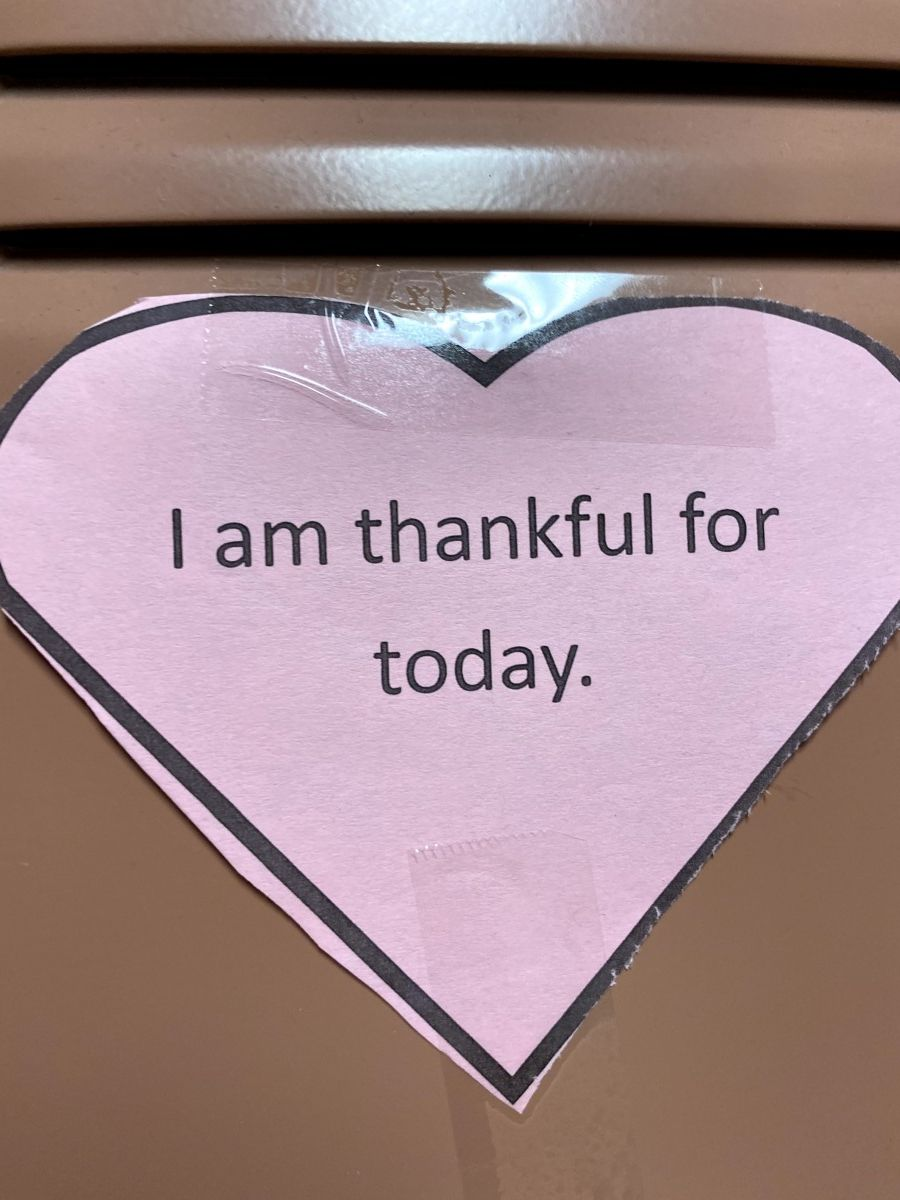 Affirmation in a heart stuck to a locker.