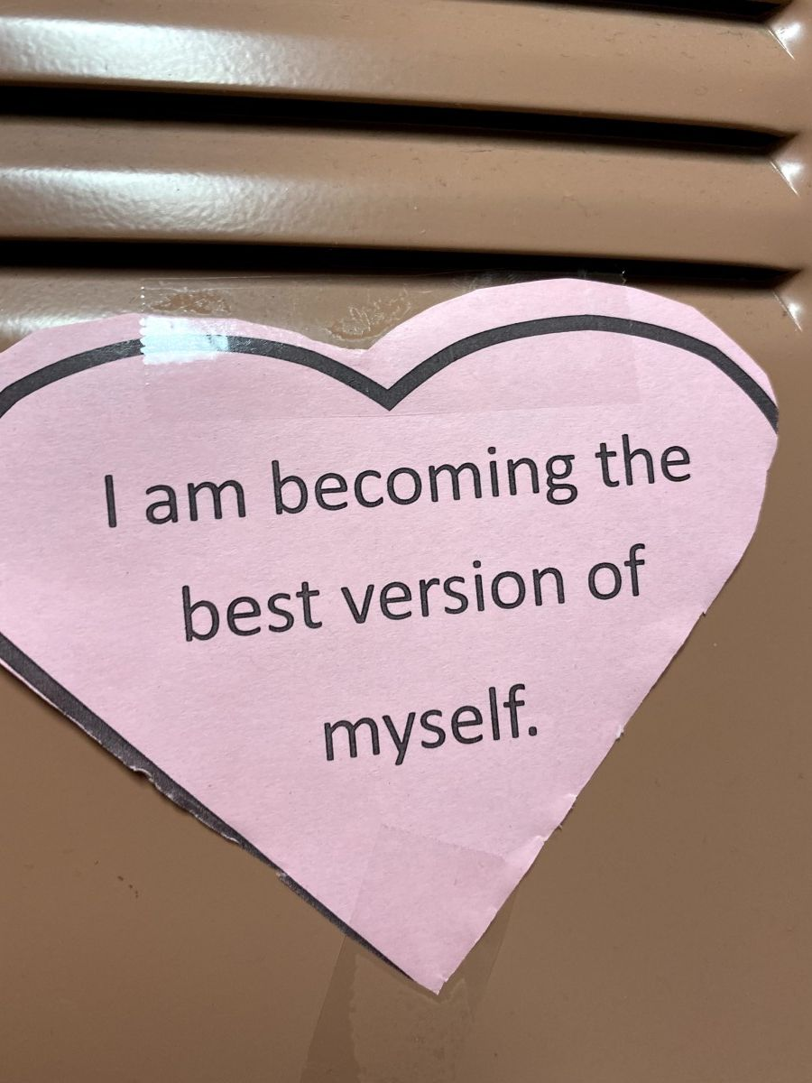 Affirmation in a heart stuck to a locker.
