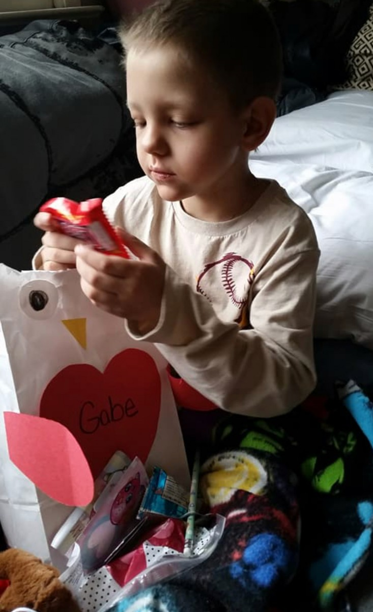 Photo of child receiving cards