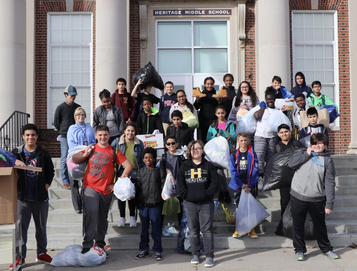 Students from project H.O.P..E pose with their donations