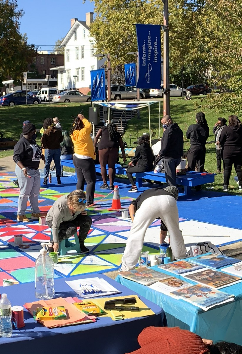 Photo of volunteers painting the Freedom Quilt.
