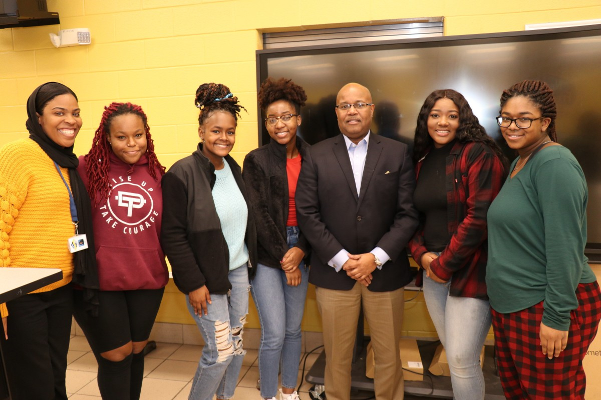 NFA Black History Club Executive Board poses for a photo with Mr. Philip Howard and Ms. Khadijah Powell.