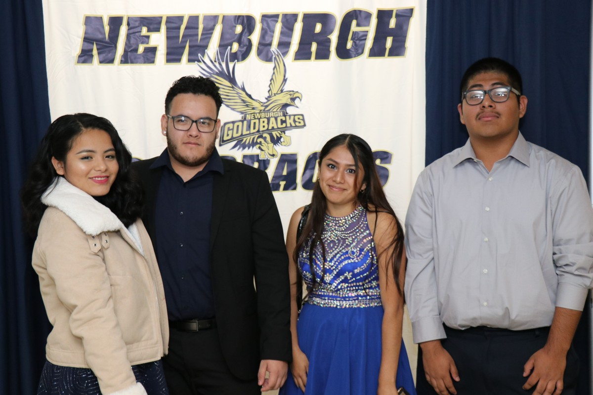 Students pose for a photo as they enter the dance.