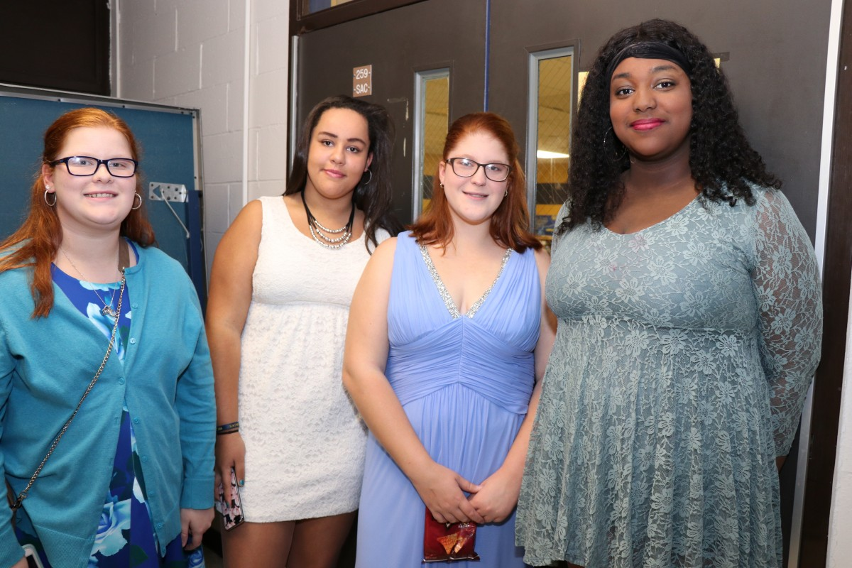 Students pose for photos at the dance.