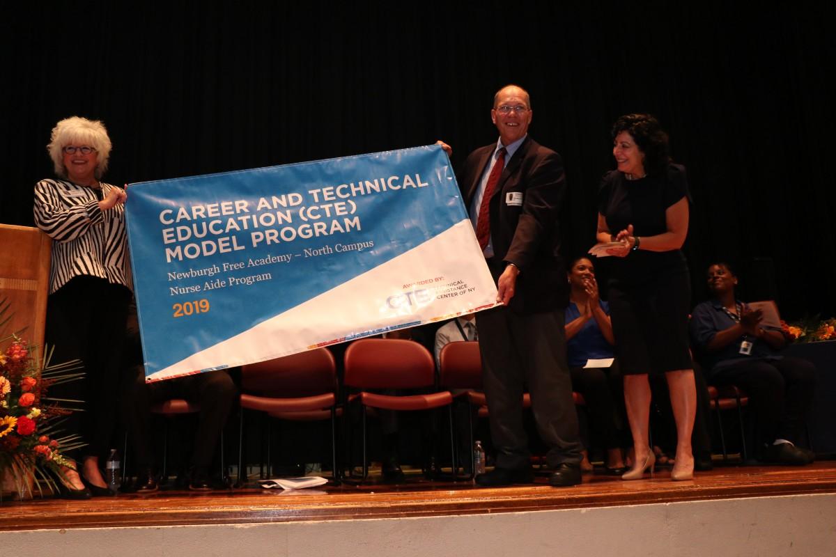 Representatives from CTE TAC present the award.