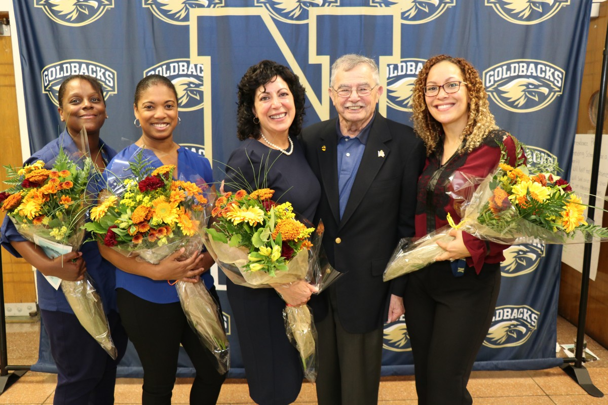CNA teachers pose for a photo with Mr. Bill Kaplan, founder of the Newburgh Armory Unity Center.