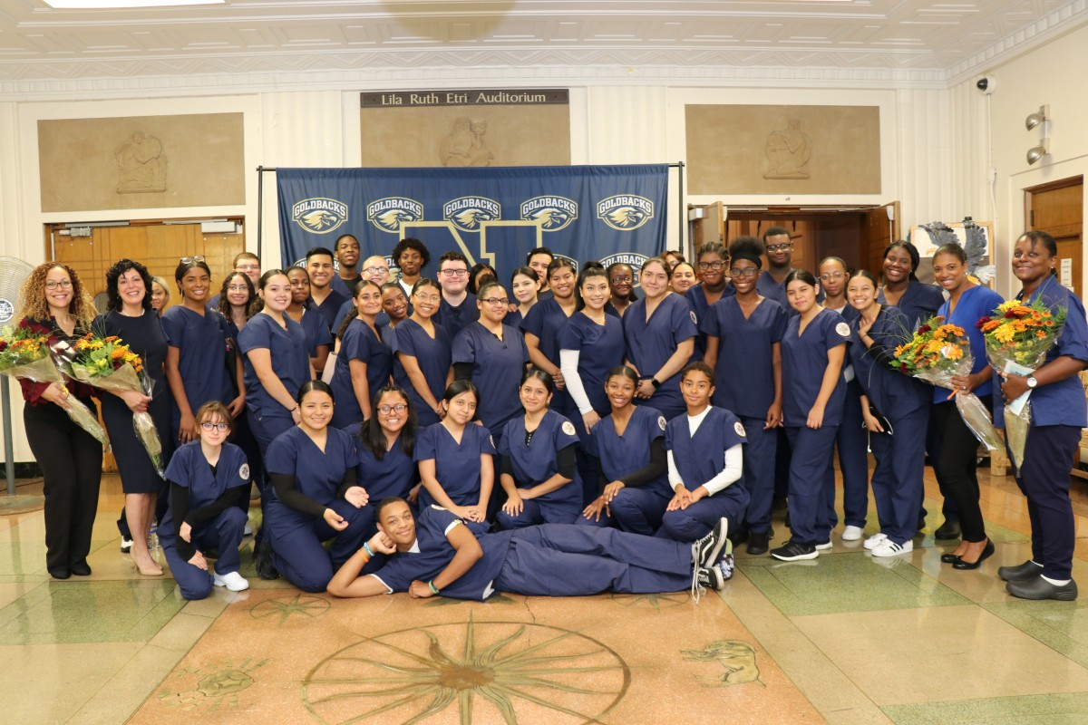 CNA scholars pose for a photo with their teachers.