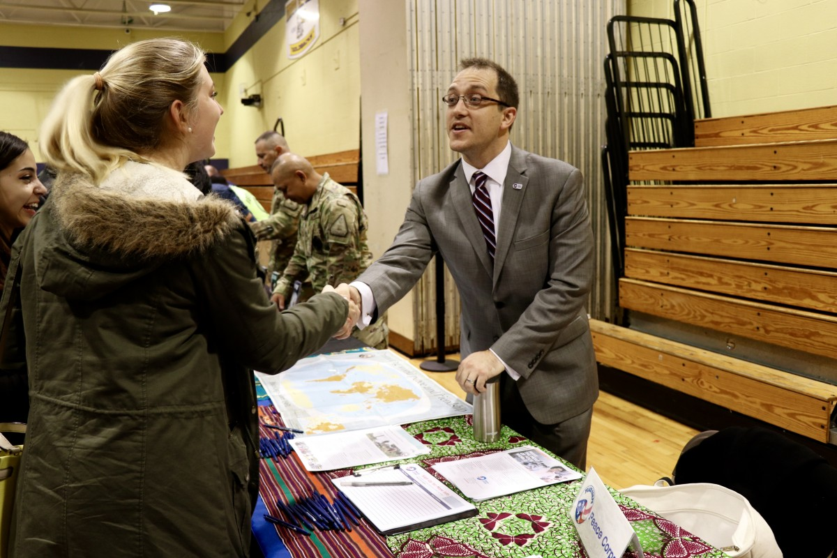 Students and parents speak with Peace Corps representative