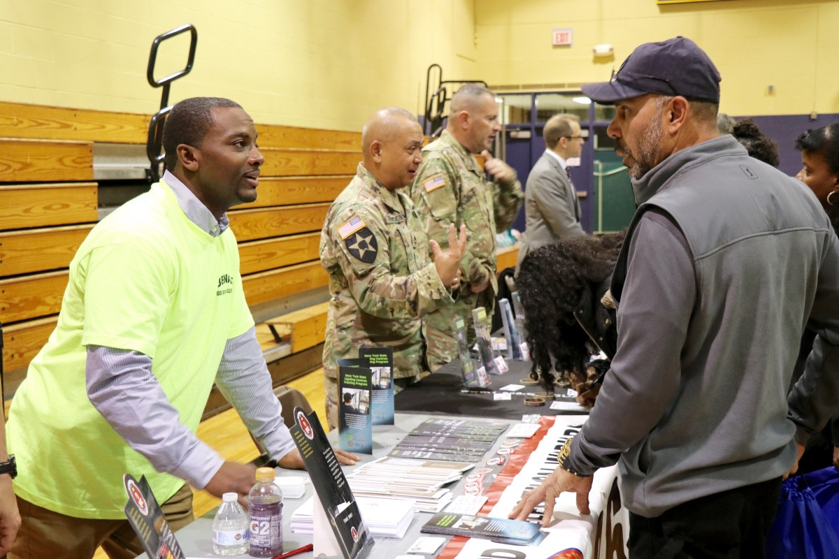 Students and parents speak with recruitment representative