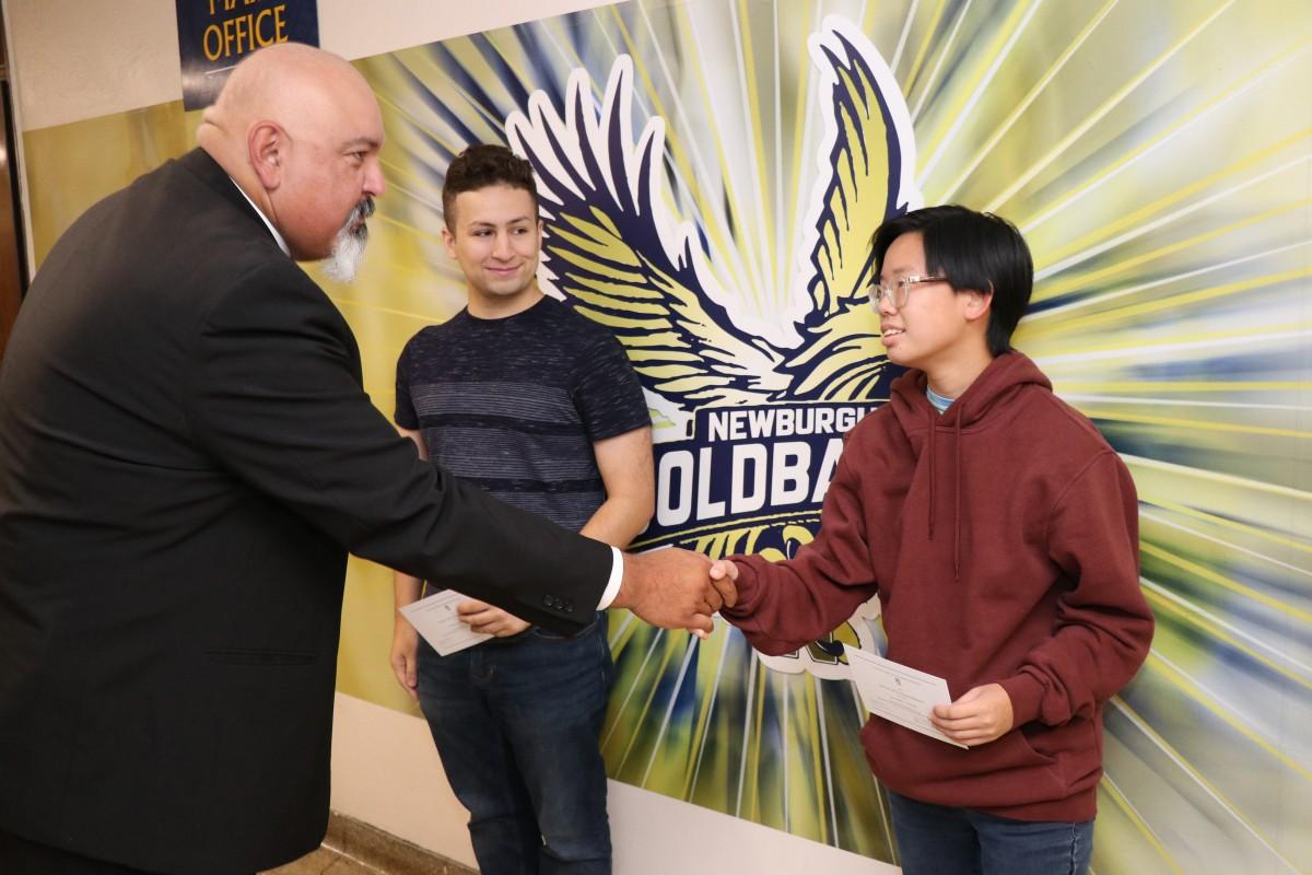 Principal, Mr. Raul Rodriguez congratulates recipient.