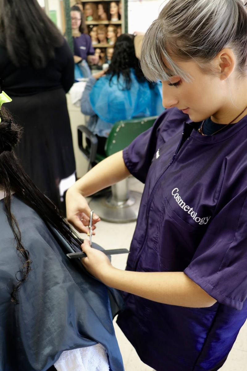 Student cuts hair