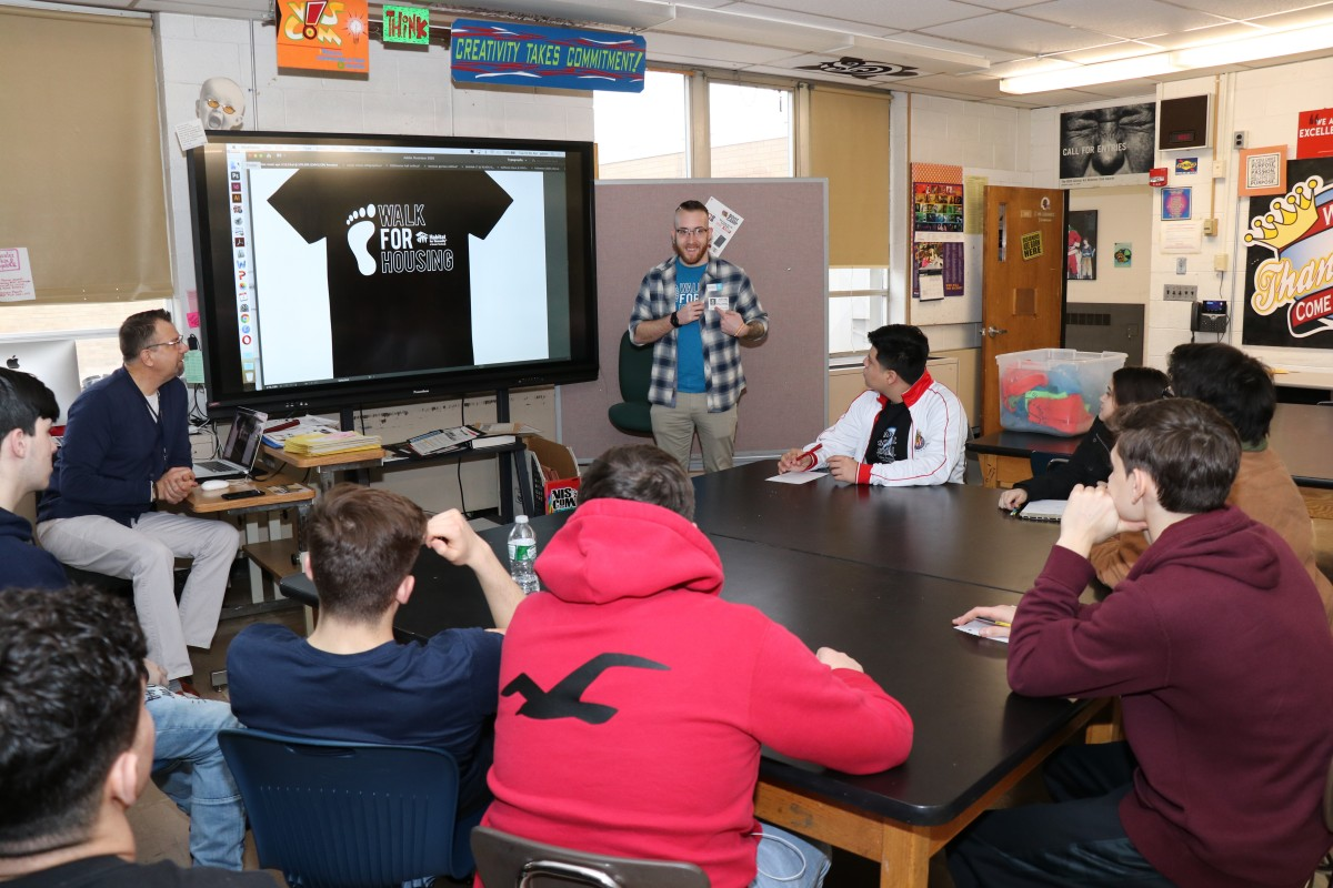 Students listen to the presentation from Mr. Chasteen and teacher Mr. Gebhardt.