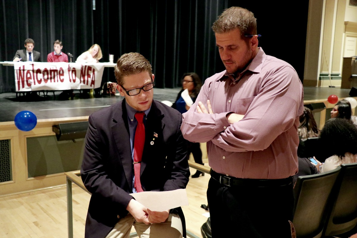 11th grader, Brandon speaks with teacher about strategy